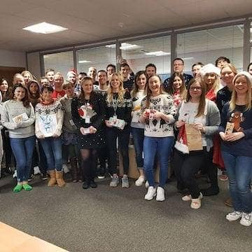 a company photo showing off our Christmas jumpers