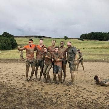 staff taking part in the Yorkshire Tough Mudder event