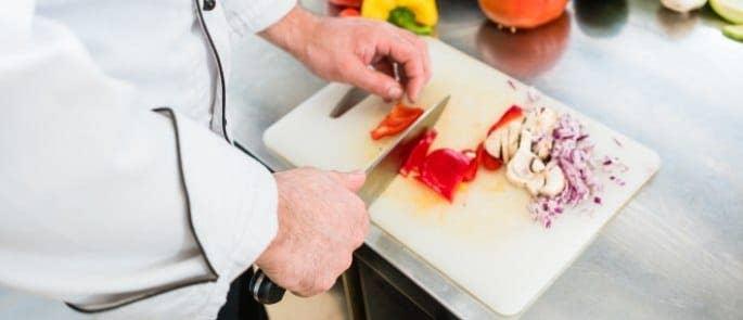chef preparing food cutting vegetables