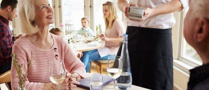 senior couple paying food restaurant