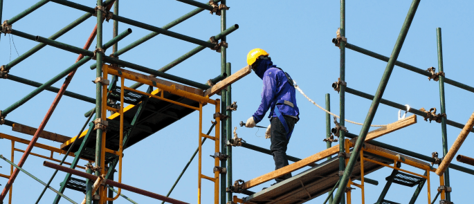 Man working at height on scaffolding
