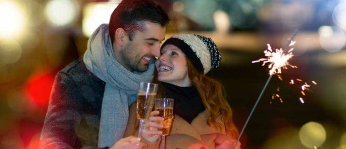 bonfire night party couple holding sparkler