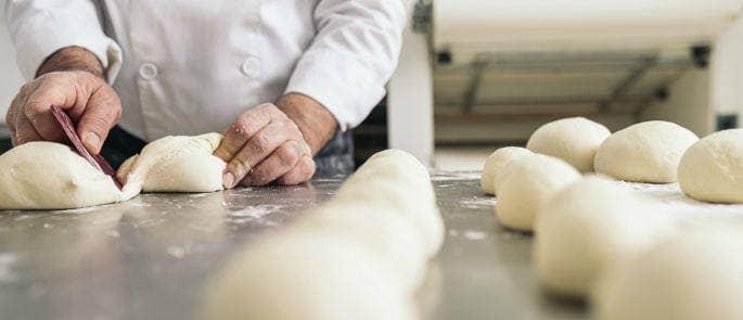 A Baker kneading dough