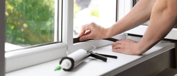 Repairman fixing window seal