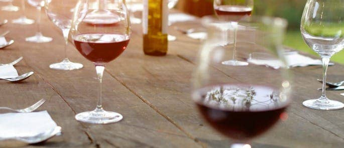 Red wine on an outdoor picnic table
