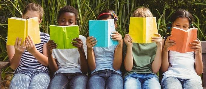Children sat reading books
