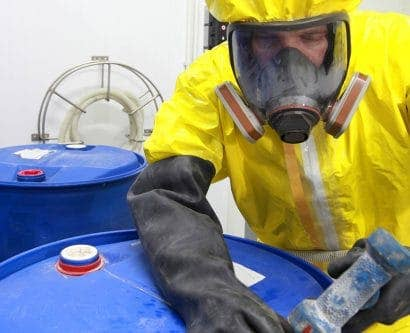 employee in PPE to deal with hazardous substances
