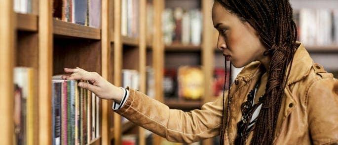 A woman choosing poetry in a bookshop