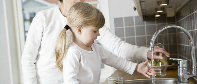 Parent teaching child the importance of handwashing