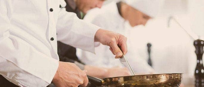basic food hygiene quiz questions  amp  answers   practice testcooks preparing raw food in the kitchen of a food premises