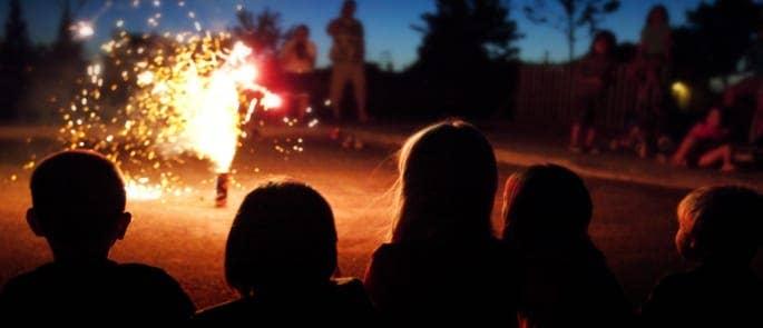 children watching fireworks display