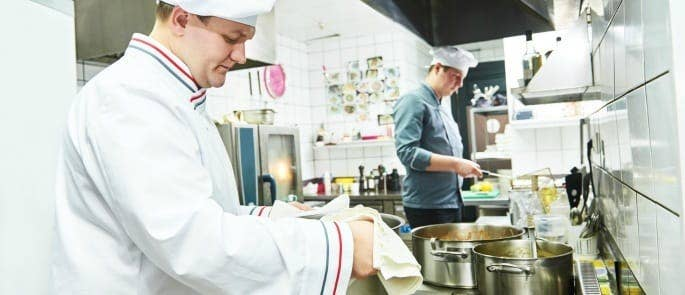 restaurant staff learning new cooking techniques