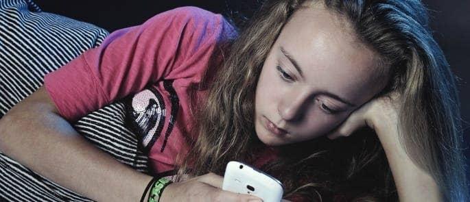 withdrawn child on phone