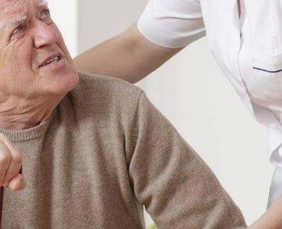carer helping older man