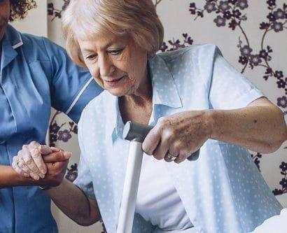 nurse assists lady