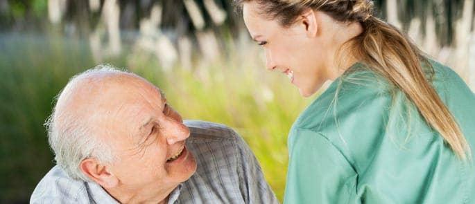 carer looking after elderly man