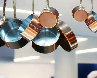 Pans hanging up in a restaurant kitchen