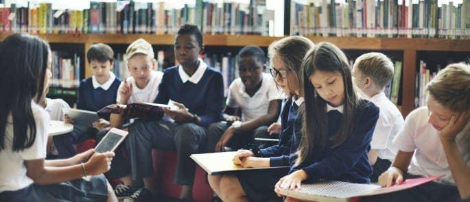 Primary school children discuss heated topics in the school library
