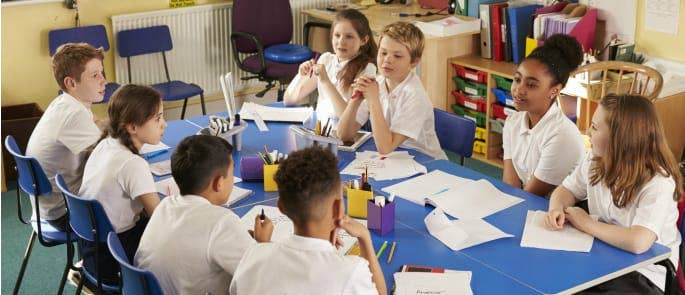 Students sat round a table discussing sensitive issues