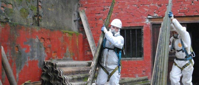 asbestos protection man removing asbestos