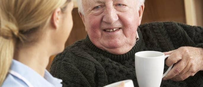 carer and resident talking care home