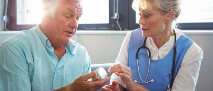 elderly man and woman care home medicine