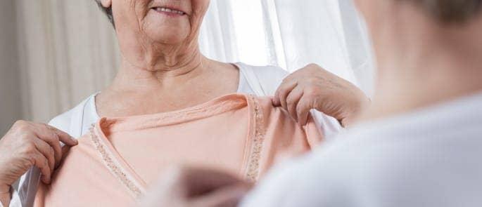 elderly woman choosing clothes