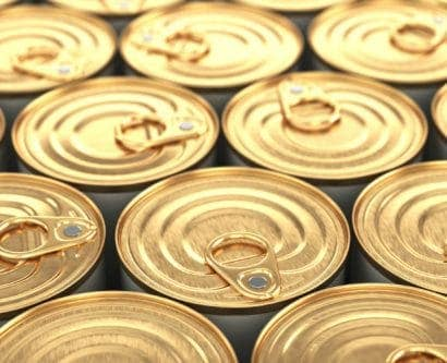 an image of lots of golden tin cans next to each other
