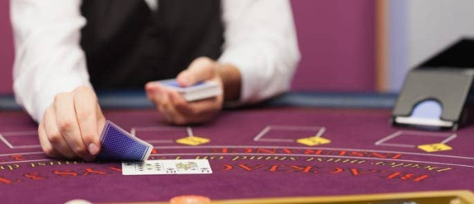 dealing cards in casino