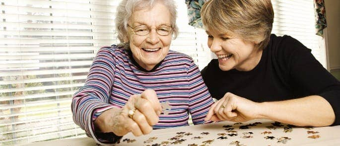 carer and patient doing a jigsaw