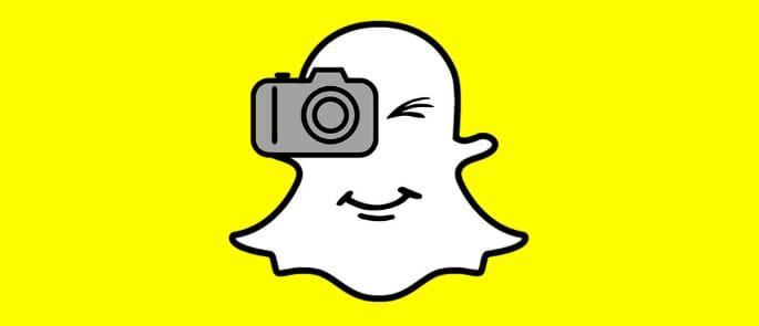 The Snapchat symbol taking a photo