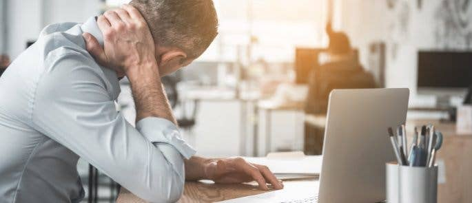 Employee with neck strain as a result of using an incorrectly set up workstation