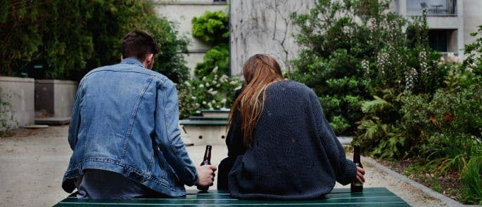 young people drinking in a park
