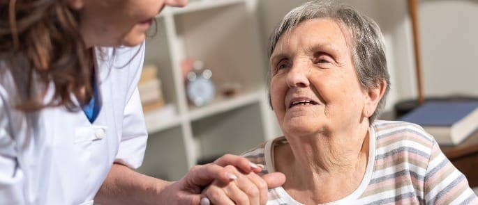 carer talking with a patient