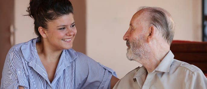 A nurse assessing the needs of a vulnerable adult and providing appropriate care