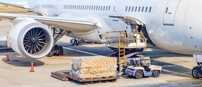 Man loading cargo onto an aeroplane