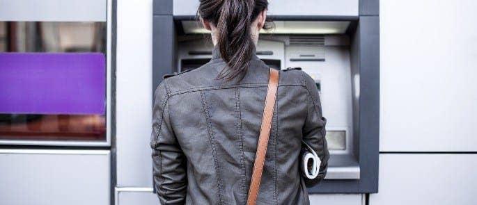 Woman Using a Cash Machine