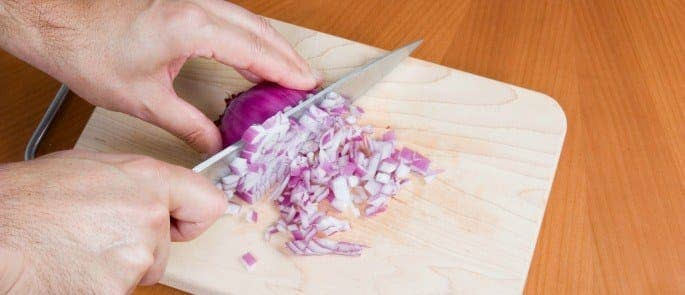 chef chopping onions