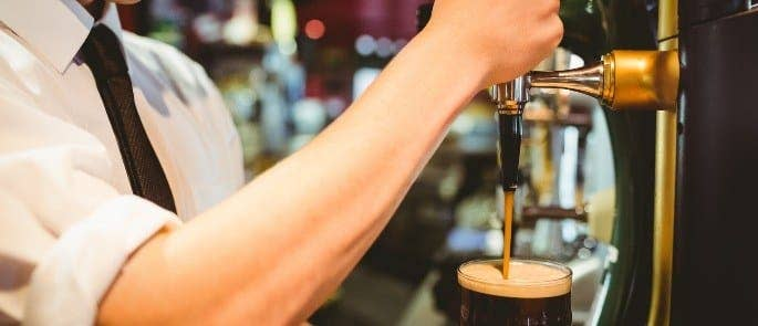 Bartender pulling a pint