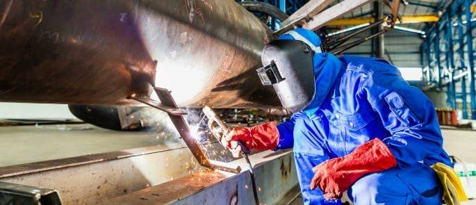 welder using PPE to carry out job safely