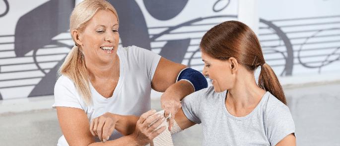 gym staff providing basic first aid