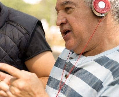 carer listens to music with service user