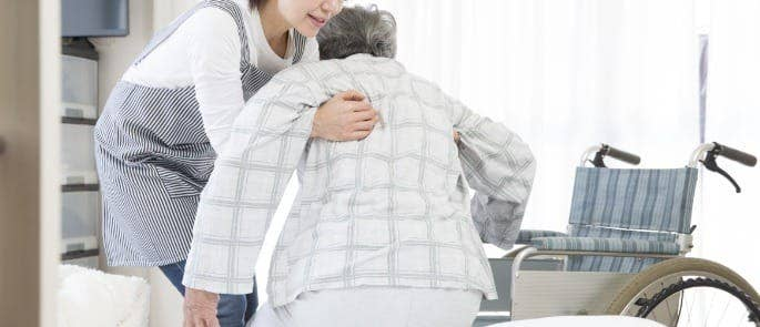 A carer assisting a resident in a care home