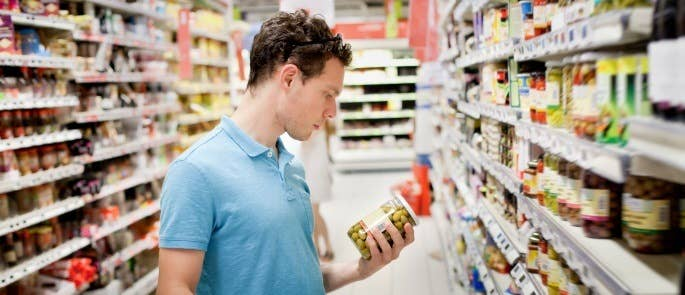 Shopper checking the nutritional information before purchasing a food product