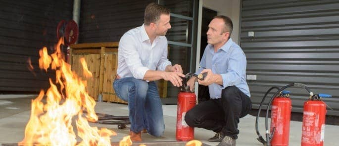 two colleagues undertaking fire warden training