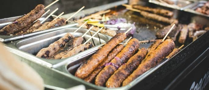 meat skewers at a street food stall