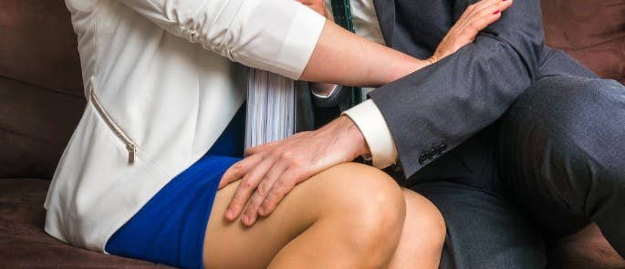 male colleague inappropriately touching fellow colleague