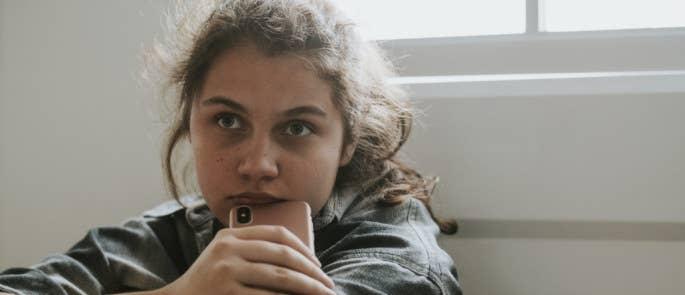 Worried teenage girl with phone