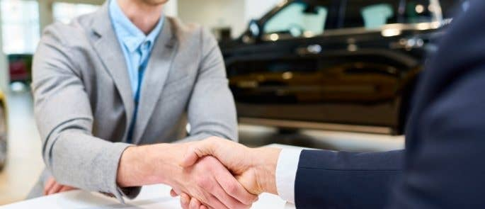 shaking hands purchasing car on credit