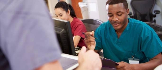 Nursing staff writing information for handover